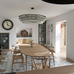Design ideas for a medium sized eclectic dining room in Oxfordshire with white walls, no fireplace and multi-coloured floors.