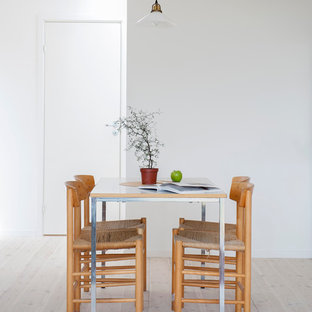 Example of a small danish light wood floor kitchen/dining room combo design in Other with white walls and no fireplace