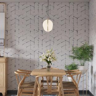 Idee per una sala da pranzo aperta verso la cucina scandinava di medie dimensioni con pareti blu, pavimento con piastrelle in ceramica e pavimento nero
