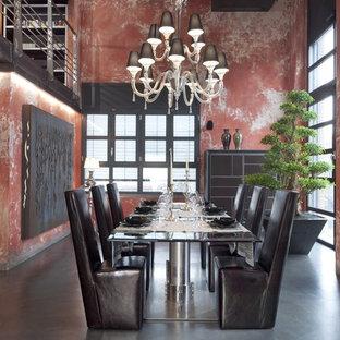 Inspiration för en stor industriell matplats, med betonggolv och röda väggar