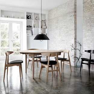 Urban concrete floor dining room photo in New York