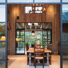 Rustic Dining Room by Cornerstone Architects