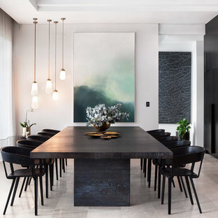 Diseño de comedor minimalista, abierto, con paredes grises y suelo gris