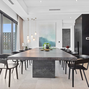 Contemporary kitchen/dining combo in Perth with white walls and beige floor.