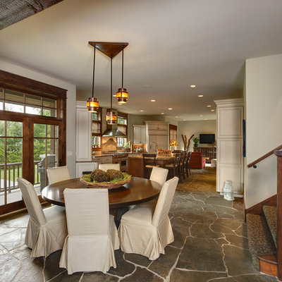 Example of a mountain style slate floor great room design in Chicago with beige walls and no fireplace