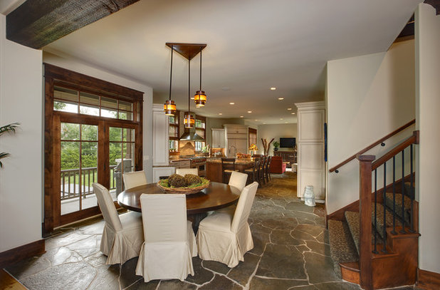 Rustic Dining Room by Charleston Building and Development