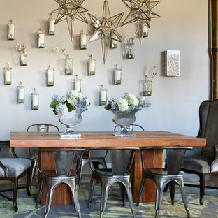 Transitional medium tone wood floor dining room photo in Denver with gray walls