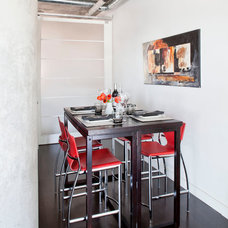 Industrial Dining Room by Rad Design Inc
