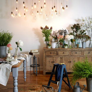 Photo of a shabby-chic style dining room in New York with white walls and medium hardwood floors.