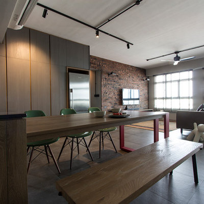Inspiration for an industrial gray floor kitchen/dining room combo remodel in Singapore with beige walls