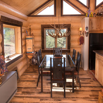 Inspiration for a mid-sized rustic medium tone wood floor and beige floor kitchen/dining room combo remodel in Salt Lake City with beige walls and no fireplace