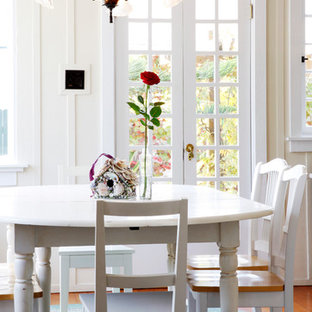 Inspiration for a timeless dining room remodel in San Diego with white walls