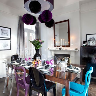 Inspiration for a contemporary dark wood floor dining room remodel in London with white walls and a standard fireplace