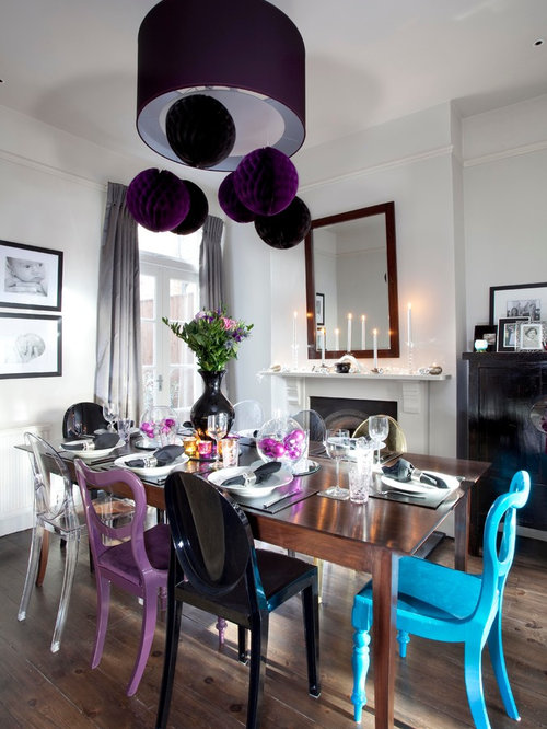 Inspiration For A Contemporary Dark Wood Floor Dining Room Remodel In London With White Walls And
