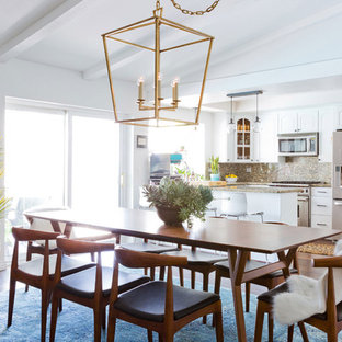 Example of a mid-sized 1950s dark wood floor kitchen/dining room combo design in Los Angeles with white walls
