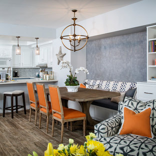 Inspiration for a mid-sized transitional brown floor kitchen/dining room combo remodel in Los Angeles with gray walls