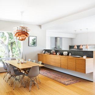 Great room - mid-century modern medium tone wood floor and brown floor great room idea in San Francisco with white walls