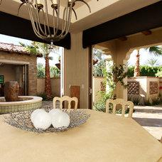 Mediterranean Dining Room by Pekarek Crandell Architects