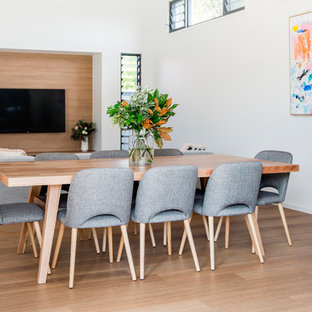 Inspiration for a contemporary open plan dining in Sunshine Coast with white walls, light hardwood floors, no fireplace and beige floor.