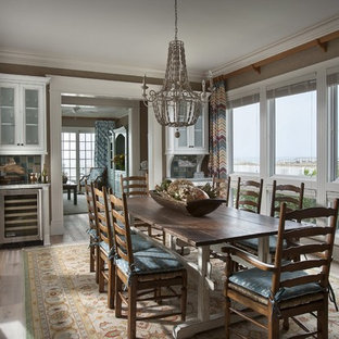 Photo of a beach style separate dining room in Charleston with brown walls, dark hardwood floors and no fireplace.