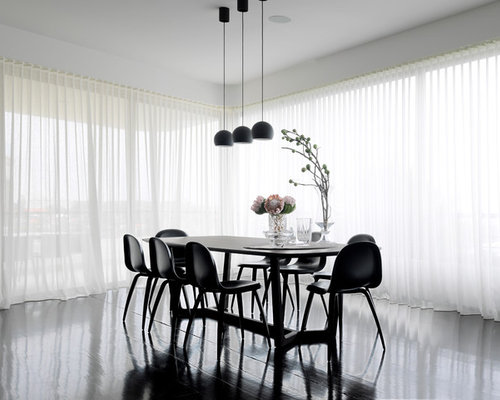 dining room idea in sydney with white walls and dark hardwood floors