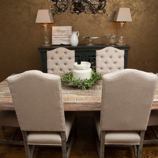 Example of a mid-sized cottage dark wood floor dining room design in Other with metallic walls