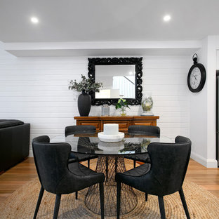 Scandinavian open plan dining in Sydney with white walls, light hardwood floors and no fireplace.
