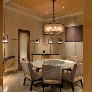 Foto di una sala da pranzo etnica con pareti beige