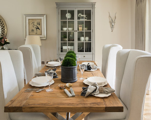 Country Dining Room Photo In London With Beige Walls And Light Wood Floors