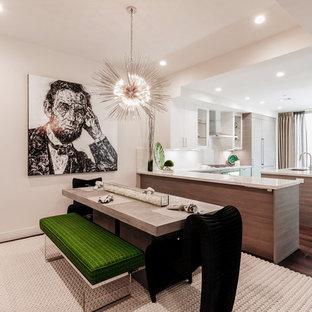 Idee per una grande sala da pranzo aperta verso la cucina minimal con pareti beige, moquette, nessun camino e pavimento beige