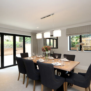 Medium Sized Modern Enclosed Dining Room In Buckinghamshire With Grey Walls Carpet And Beige Floors