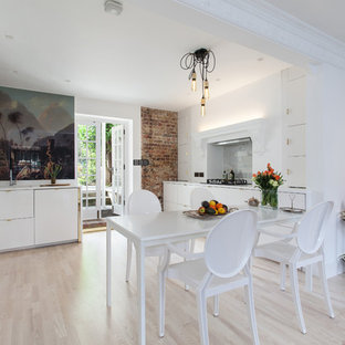 Design ideas for a medium sized contemporary dining room in London with white walls and light hardwood flooring.