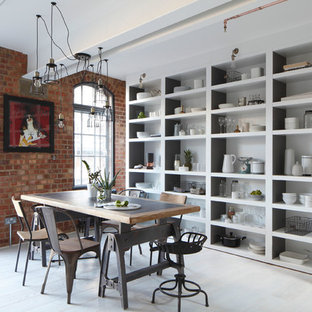 Inspiration for a large industrial dining room in London with painted wood flooring.