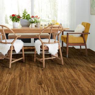 Idee per una grande sala da pranzo aperta verso la cucina scandinava con pareti bianche, pavimento in vinile e nessun camino