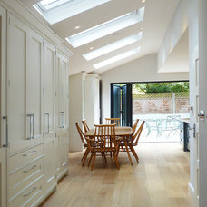 Transitional Dining Room by POW Architects