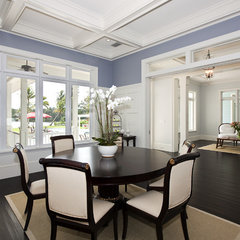 tropical dining room by Mackle Construction