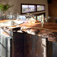 Rustic Dining Room by Brunelleschi Construction