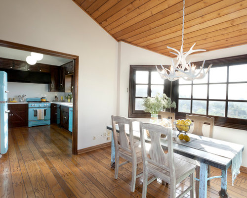 White antler chandelier houzz inspiration for a rustic medium tone wood floor dining room remodel in new york with white mozeypictures Image collections