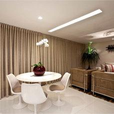 Contemporary Dining Room by Vanja Maia - Arquitetura e Design de Interiores