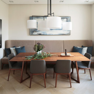 This Is An Example Of A Retro Dining Room In London With Light Hardwood Flooring And