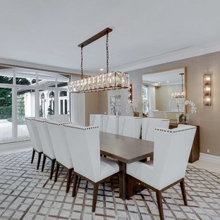 Example of a mid-sized transitional concrete floor and white floor great room design in Miami with beige walls