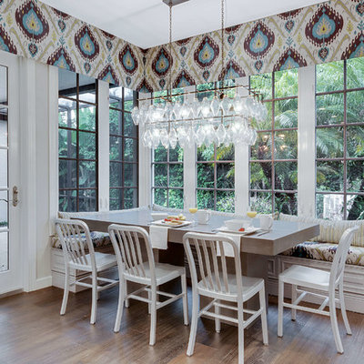 Kitchen/dining room combo - mid-sized transitional dark wood floor and brown floor kitchen/dining room combo idea in Miami with gray walls and no fireplace