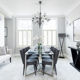 This is an example of a medium sized classic dining room in London with grey walls, carpet, grey floors and no fireplace.