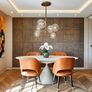 Design ideas for a contemporary dining room in Kent with grey walls, medium hardwood flooring, no fireplace, a drop ceiling and panelled walls.