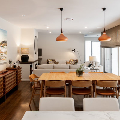 Mid-sized trendy medium tone wood floor and brown floor dining room photo in Melbourne with white walls