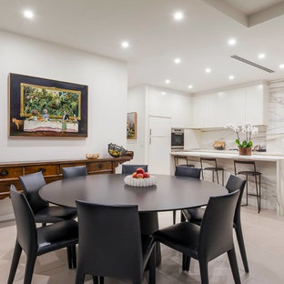 Design ideas for a transitional kitchen/dining combo in Melbourne with white walls and grey floor.