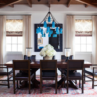 Dining room - beach style dark wood floor dining room idea in Los Angeles with white walls