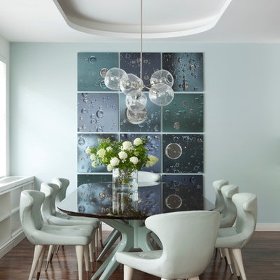 Trendy dark wood floor dining room photo in New York with blue walls and no fireplace
