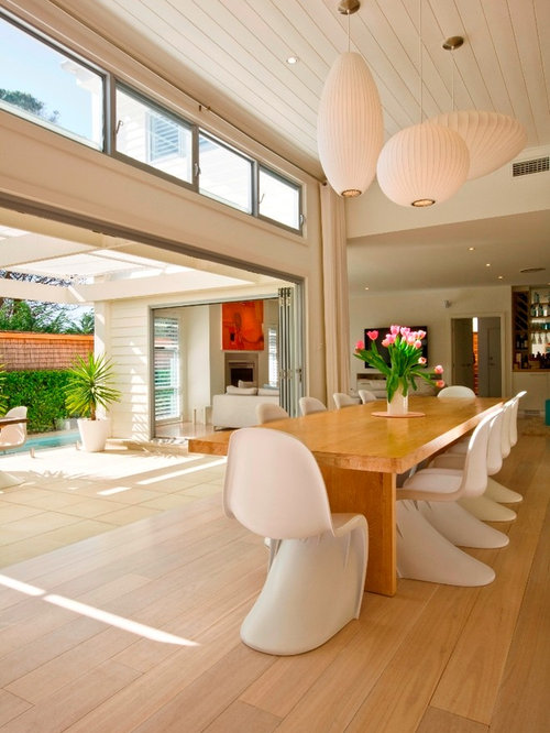 Inspiration For A Contemporary Dining Room Remodel In Sydney With Beige Walls And Medium Tone Wood