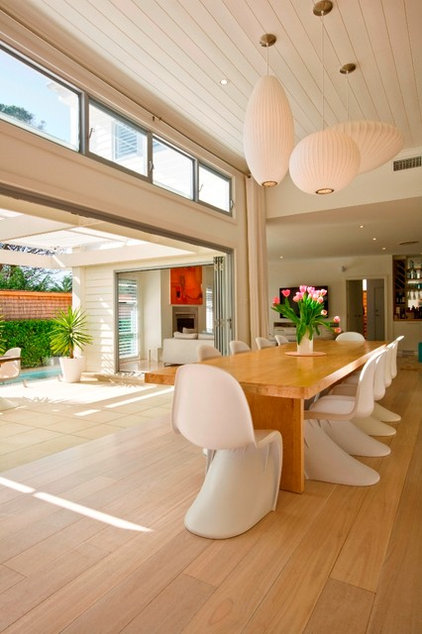 Contemporary Dining Room by Sanctum Design
